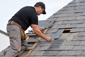 roofing contractor performing roof replacement